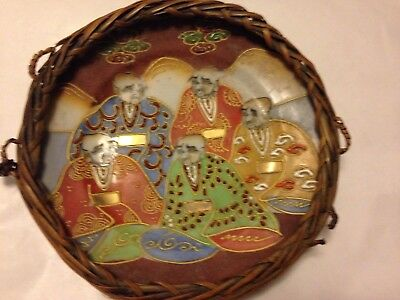 A Japanese or Chinese plate ornament