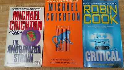 Three medical mystery paperbacks - Two Michael Crichton and one Robin Cook
