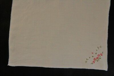 Vintage cream linen tray cloth with hand embroidered flowers on one corner.