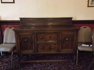 Solid Oak Sideboard.   Large And Very Heavy  Beautiful Desighn  look at photos
