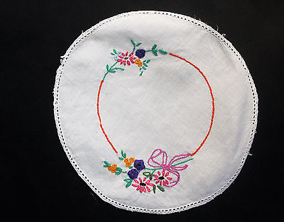 Vintage white round cloth with hand embroidered flowers.