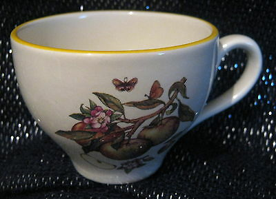 Pretty Prinknash Pottery cup with apple blossom design approx 2.75 ins diameter