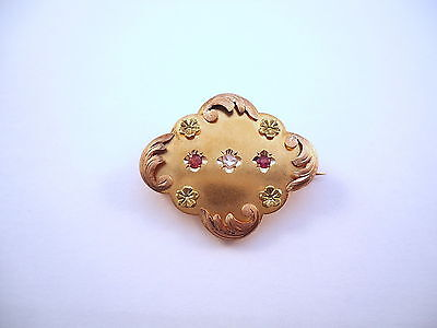 JOLIE BROCHE ANCIENNE POLYLOBEE EN OR 18K, DIAMANT ET RUBIS, or 18 carats.