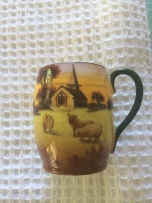 Royal Doulton Miniature Cup. About  Tall. Has Sheep And Church. Lovely Piece.