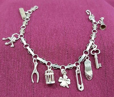 Sterling Silver Charm Bracelet With 9 Silver Charms
