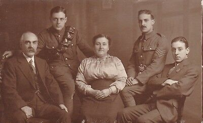 Pc Photo Family with 2 Soldiers and one 'On War Service' badge. Todmorden Yorks