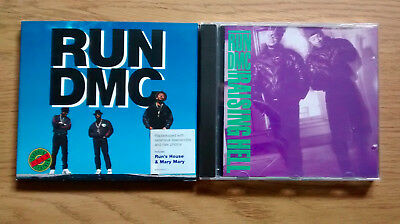 Run DMC, Tougher Than Leather and Raising Hell, 2 CD albums sold as one lot