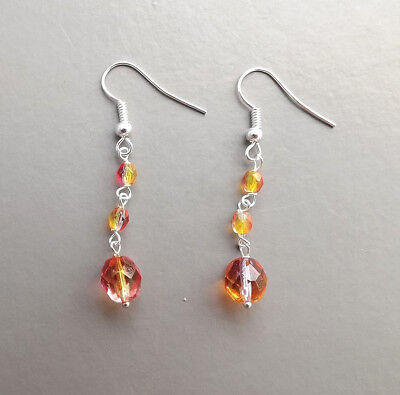 Orange yellow glow crystal drop earrings .. glass Czech bead silver tone jewelry