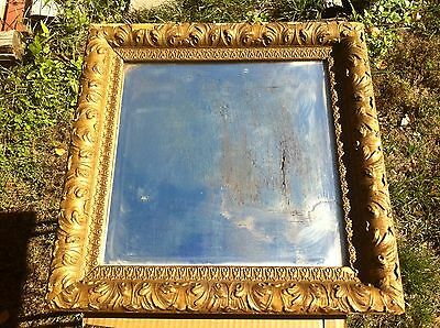 Vintage 1800s Beveled glass mirror in wood pressed carving on frame