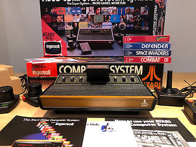 Atari 2600 VCS with Brand New REPRO Packaging. Pristine Condition!