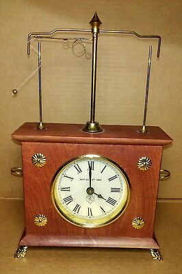 VINTAGE FLYING PENDULUM CLOCK HOROLOVAR JEROME & Co. 100% COMPLETE AND WORKING.