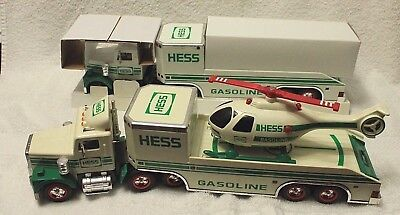 2 ~1995 Hess Truck and Helicopter, One still in original packing, working lights