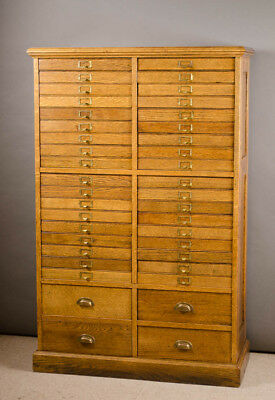 AN OAK FORTY-DRAWER FILE CABINET, American, c. 190 Lot 24
