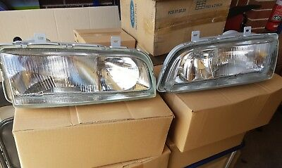 New Genuine Ford Headlights LH & RH suit EA EB ED NOS XR6 FALCON.