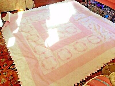 Antique Quilt done in the pinks and white. also they have embroideredf lower