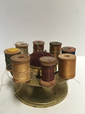 Antique brass bobbin holder with pin cushion