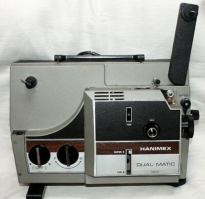 Hanimex duorama-IQ  Super and Standard film projector ,box ,with book, as NEW