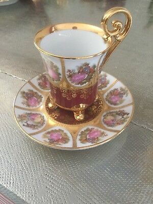 "A Beautiful Cup And Saucer ""La-Reine"" Hand Decorated 22 Karat Gold"