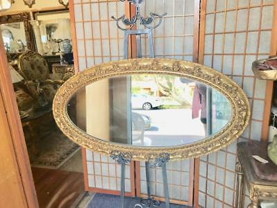 LARGE ORNATELY CARVED  GOLD FRENCH LOUIS BEVELLED OVAL MIRROR 120 X 60cm
