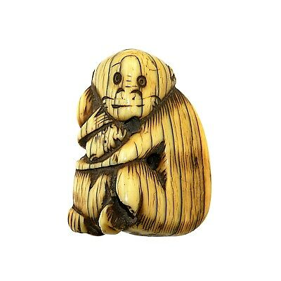 (2081) Antique Chinese toggle depicting an ape with child