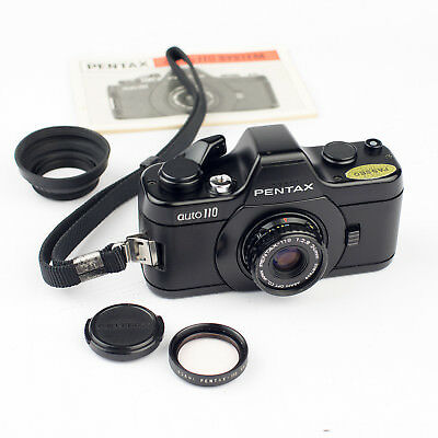 PENTAX AUTO-110 CAMERA + 24mm f/2.8 LENS + FILTER + HOOD + MANUAL + STRAP. EXC++
