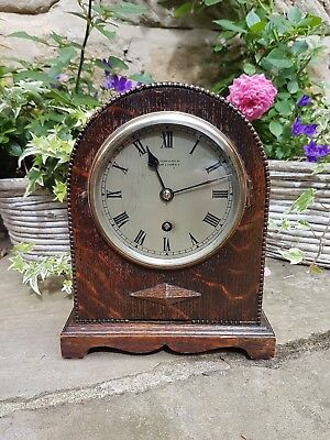 A 1920s oak mantel clock by Gillett & Johnson retailed by H L Brown & Sons