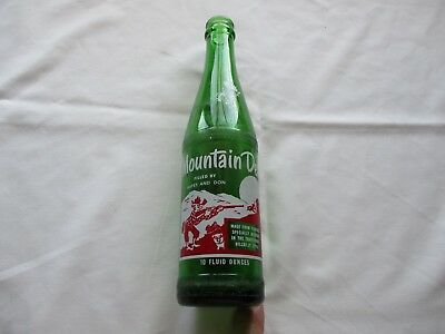1965 named Mountain Dew Hillbilly Soda Bottle Filled by : HAYES and DON   10 0z.