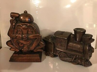 2 Vintage Copper Colored Cast Metal  Still Coin Banks Train and Clock with Faces