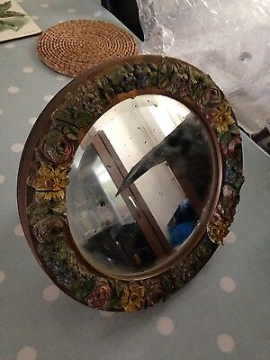 An old mirror with flowers made of  plaster