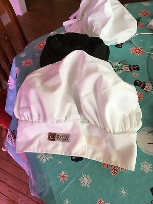 2 White Chefs Hats And A Black Chefs Beanie Cap