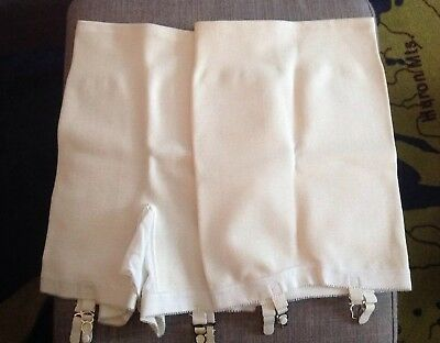 NOS 2 vintage Carole Brent girdles with garters. Open bottom size large.