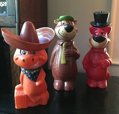 Vintage Hanna-Barbera Toy Banks, Yogi Bear, Huckleberry Hound, and Baba Looey