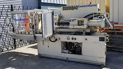 Used Krauss Maffei KM 80-390 C2 Injection moulding machine For Parts Or Repair