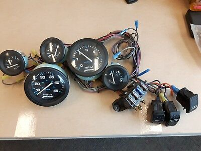 Old Stock Mercury Gauge Set, Tach, Speed, Fuel Level, Trim and Voltage w/wiring