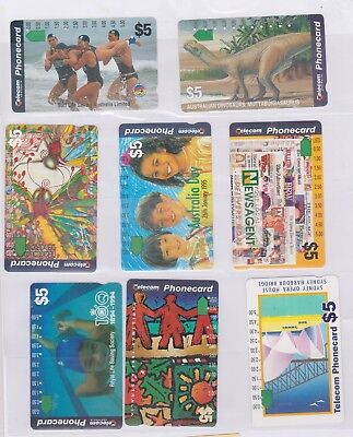 (K70-82) AU mix of 8 cards $5 & $10 used phone cards (CG)