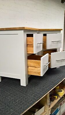 Matching pair of bedside cabinets light grey solid Oak.