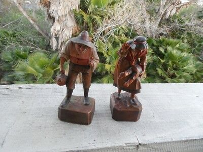 Pair of Antique Anri figurines Men with Demijohn and Woman discipline little boy