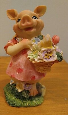 Female Pig Figurine in Pink Dress Holding a Basket of Flowers