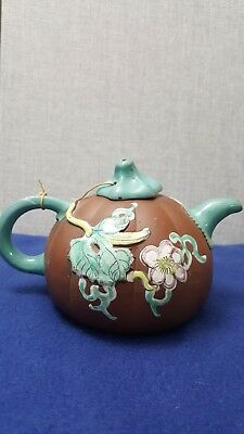 An enamelled Yi hsing ware teapot and cover in melon form 19th c