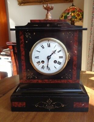 Black Slate and Red Marble chiming mantel clock, possibly French movement