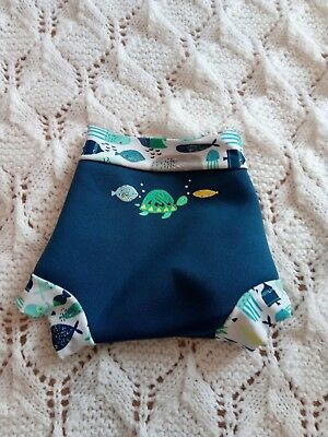 baby boy 0-3 swim tunks blue with a picture of a fish and a turtle