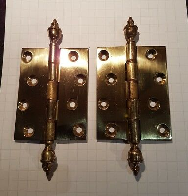 A pair of quality (heavy duty) brass hinges with exposed knuckles