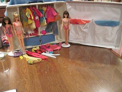 Vintage Barbie, and Two Francie Dolls in a case with 12 nice outfits