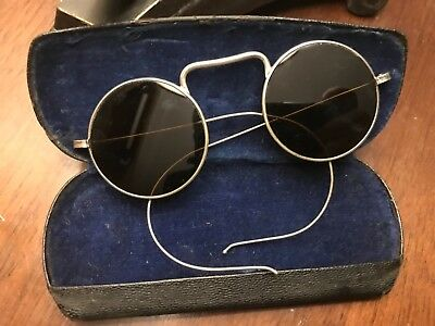 Vintage used  A O , wire rim sunglasses. With case.