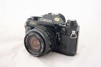 BLACK ...Canon AE-1 Program.... with nice 28mm f/2.8..... wide angle lens