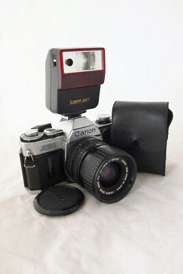 Canon AE-1 ... with clean FD 35-70mm + 244T Canon flash...ALL WORKING + TESTED