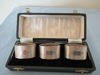 Cased set of three hallmarked silver napkin rings