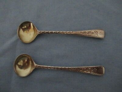 A pair of decorated Old English pattern salt spoons with gilded bowls