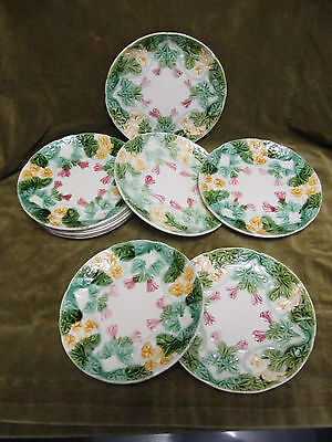 11 assiettes barbotine fleurs Orchies? (french majolica flowers plates)