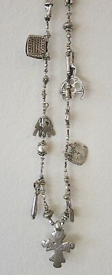 Handmade necklace with silver antique charms, amulets and Ethiopian cross